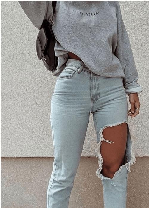 cosa mettere in valigia, jeans strappati per l'estate
